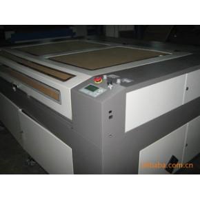 皮革激光镂空打孔切割机,布料激光冲孔机,无纺布激光冲孔机。